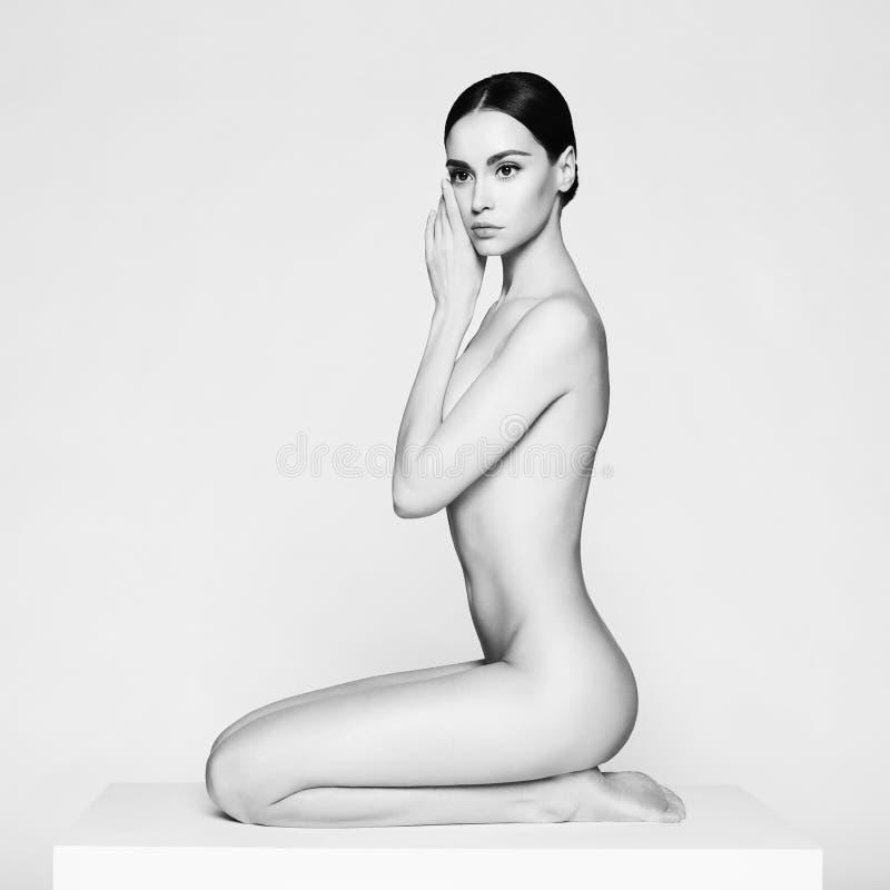 Elegant sitting lady stock images