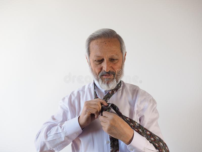 Man tying a tie royalty free stock photos