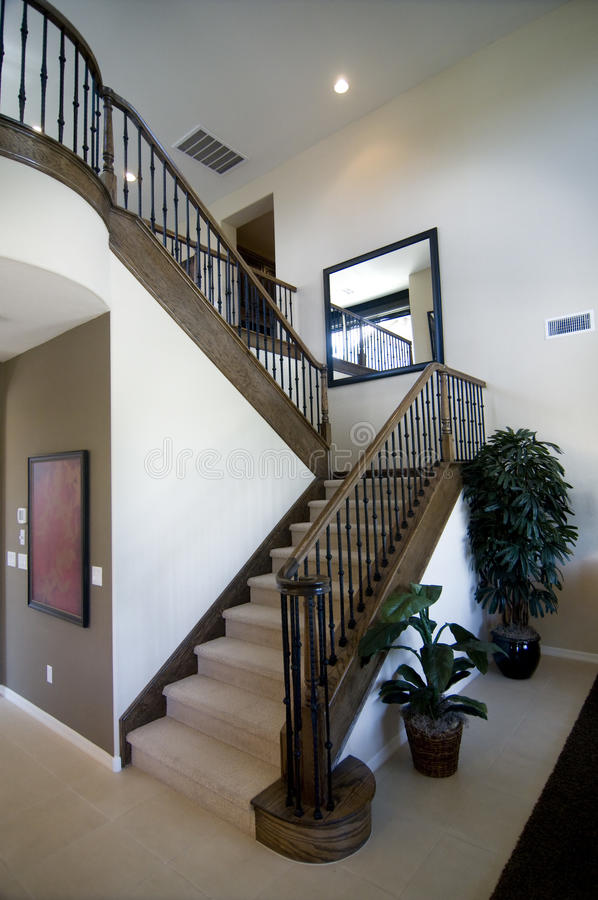 Elegant stair case and wooden banister royalty free stock photography