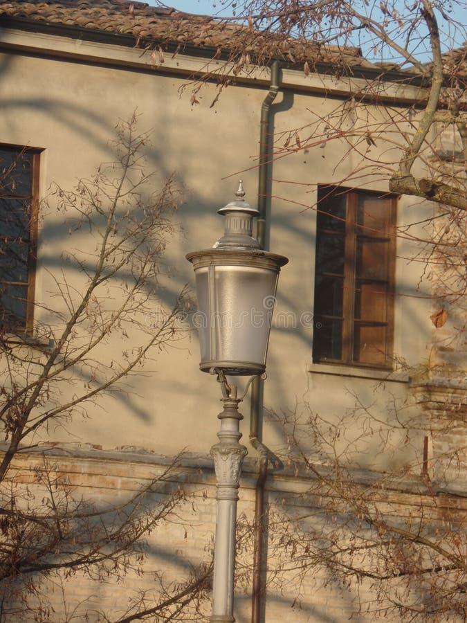 Elegant street lamp in an Italian town royalty free stock photo