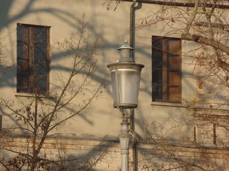 Elegant street lamp in an Italian town stock photography