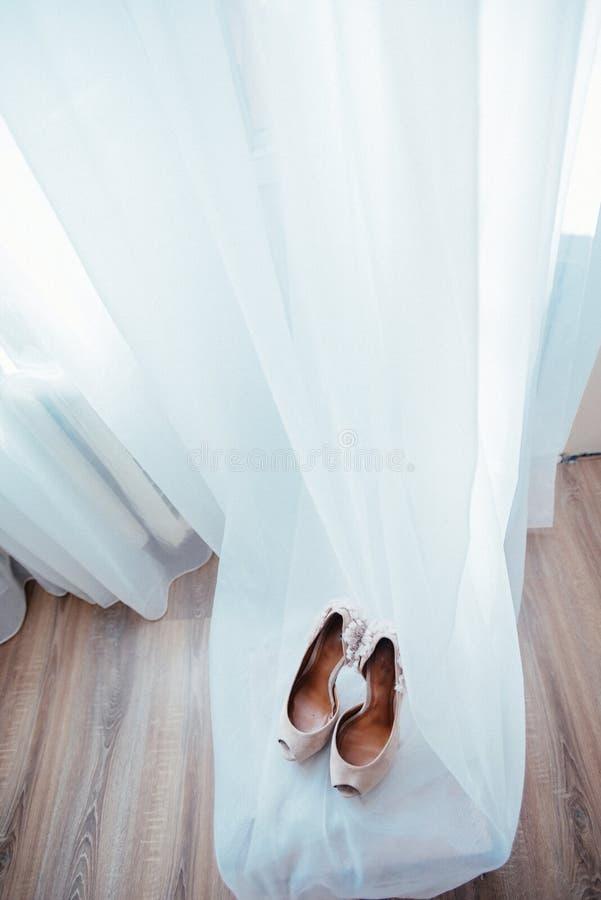 Elegant and stylish bridal shoes stock photos
