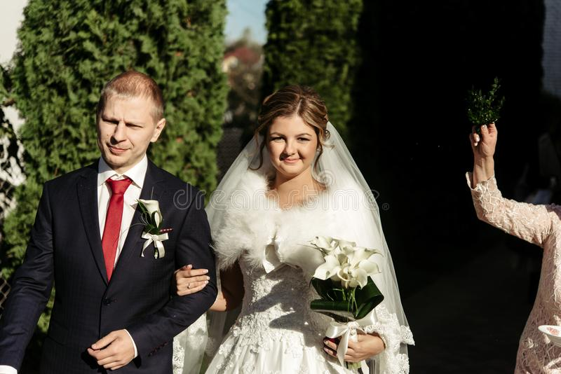 Elegant stylish bride and groom getting blessed by family, wedding day in Lviv royalty free stock image