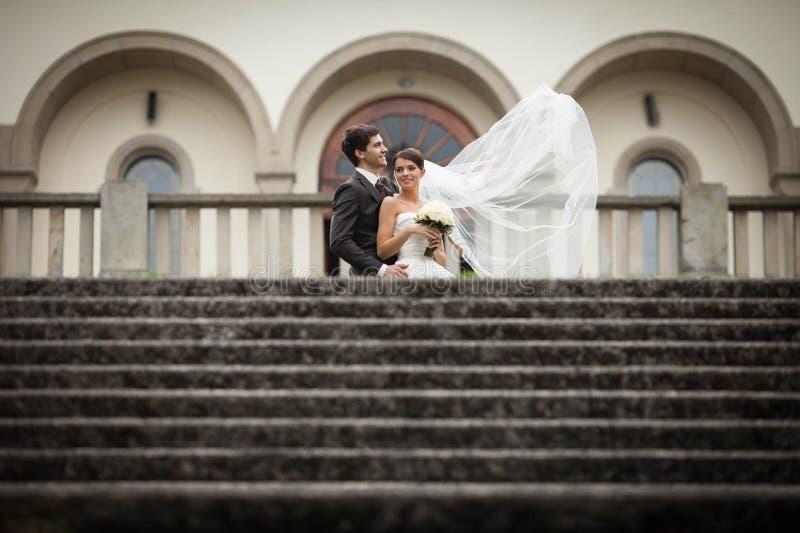 Elegant stylish young couple beautiful bride and groom stock photos