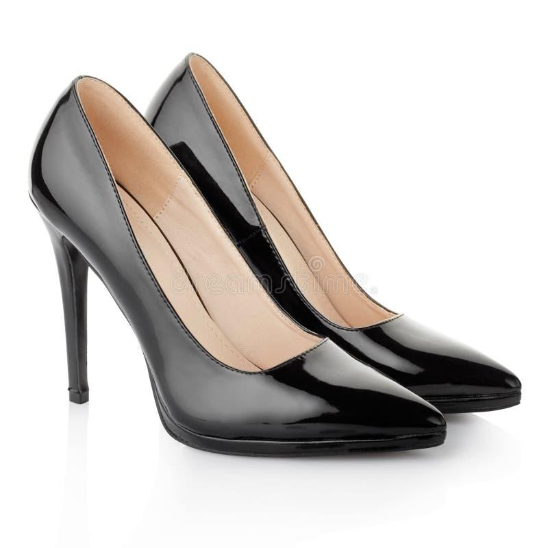 Elegant svart, skor för hög häl för kvinna fotografering för bildbyråer