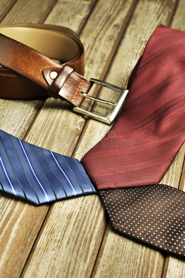Elegant syle. Still life with man fashion accessories: ties, watch, belt and wallet stock images
