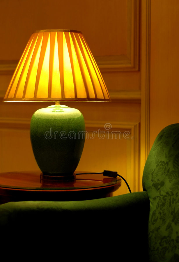 Elegant table lamp and sofa royalty free stock images