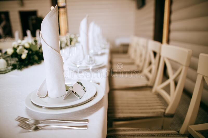 Elegant table setting  in classic white on wedding party stock photo