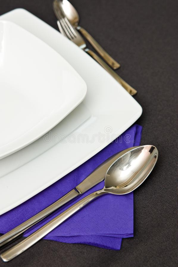 Elegant table setting with violet napkin royalty free stock images