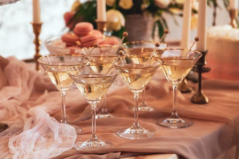 Elegant table setting martini glasses stock photo