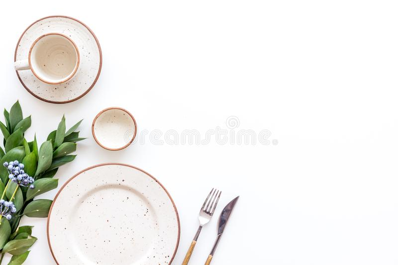 Elegant table setting with plates and tableware on white background top view mock up. Served table. Elegant table setting with plates and tableware on white stock photos
