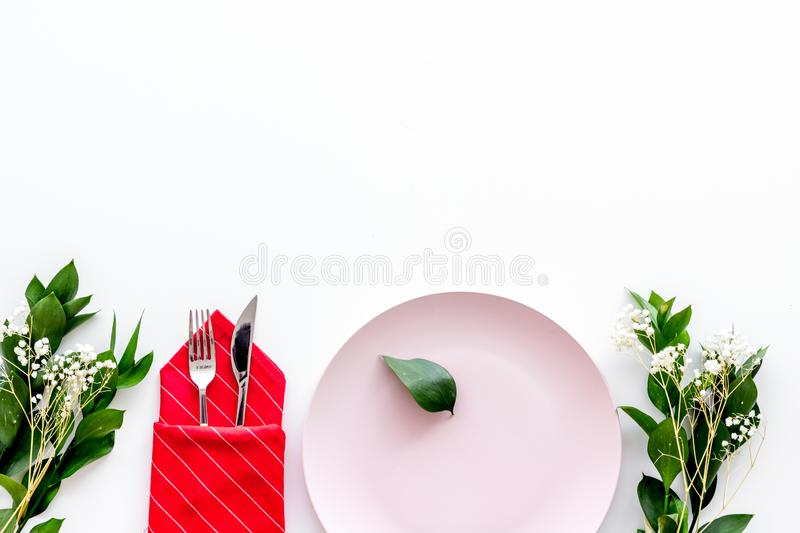 Elegant table setting with plates and tableware on white background top view space for text. Served table. Elegant table setting with plates and tableware on stock image
