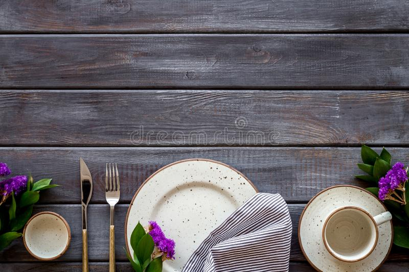 Elegant table setting with plates and tableware on wooden background top view mockup. Served table. Elegant table setting with plates and tableware on wooden royalty free stock photography