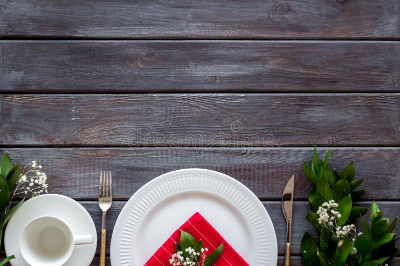 Elegant table setting with plates and tableware on wooden background top view mockup. Served table. Elegant table setting with plates and tableware on wooden stock image