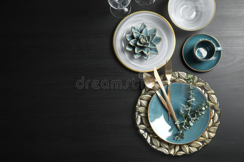 Elegant table setting and space for text on dark background stock photos