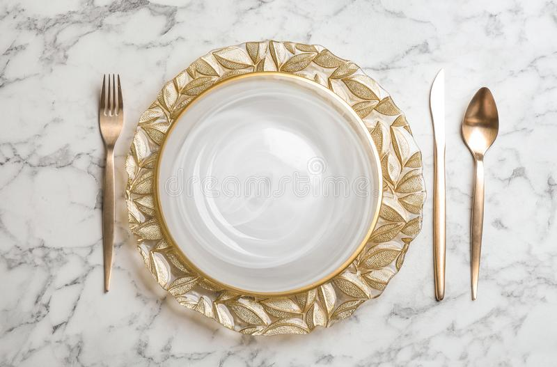 Elegant table setting on white marble background. Flat lay stock photos