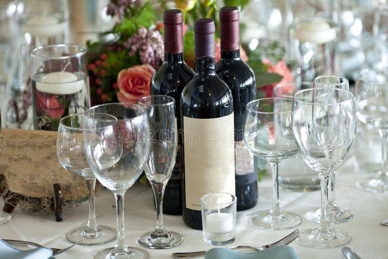 Elegant table setting with wine bottles. Elegant table setting with wine bottle and flowers stock photography