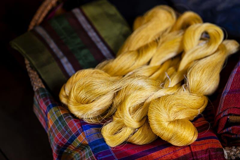 Elegant Thai Silk in the northeast Isan image of Thailand. Local silk fabric. Colorful raw Thailand silk thread.  stock photo