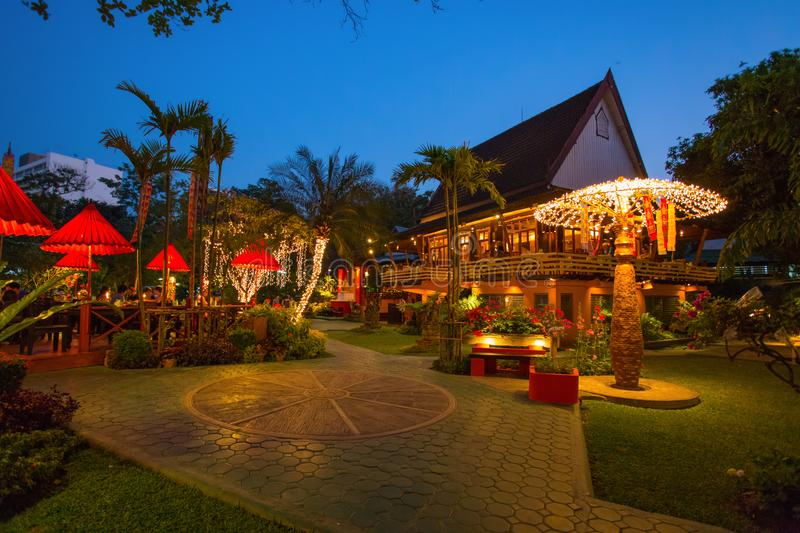 An elegant and typical thai restaurant in Chiang Mai by night, Thailand. stock photography