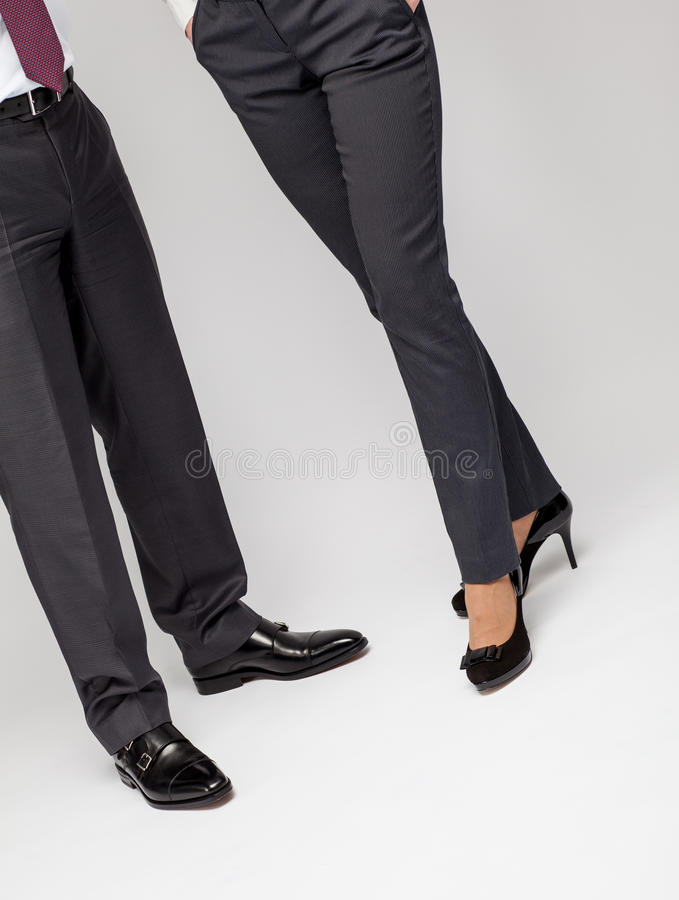 Elegant unrecognizable businessman and business lady stock photos