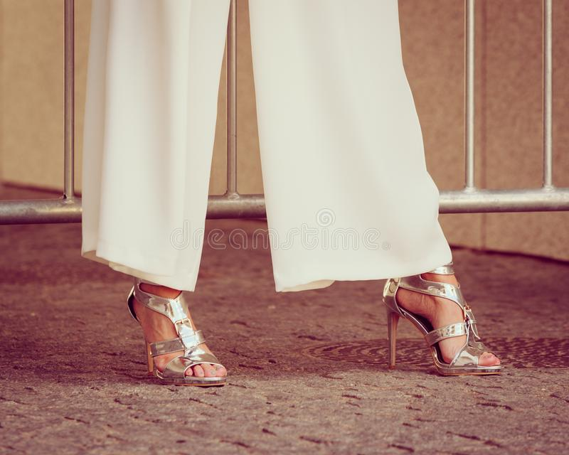 Woman wearing high heels and culottes. Elegant unrecognizable woman presenting fashionable urban outfit. High heels and trousers culottes stock images