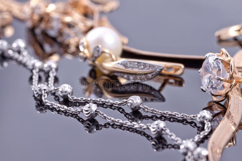 Elegant unusual silver chain and gold jewerly stock images