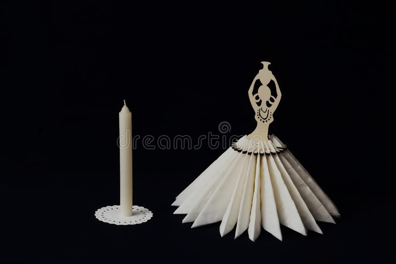 Elegant vintage stylized napkin stand and wax candle on white lace napkin on black background. Minimal style. Concept - serving, stock photos