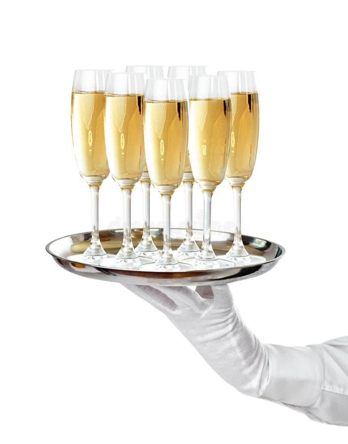 Elegant waiter serving champagne on tray royalty free stock photos