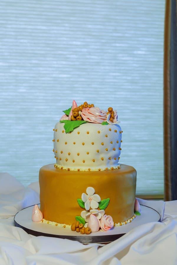 Elegant wedding cake with flowers succulents stock image