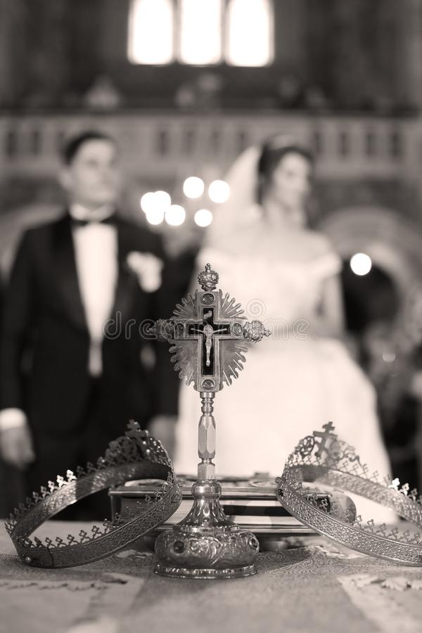 Elegant wedding crowns for young couple. Elegant wedding crowns or tiara preparing for marriage in church, cathedral royalty free stock image