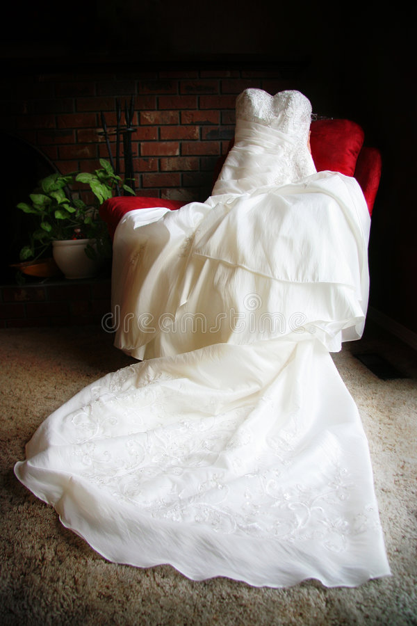 Elegant Wedding Dress On Chair Royalty Free Stock Photography