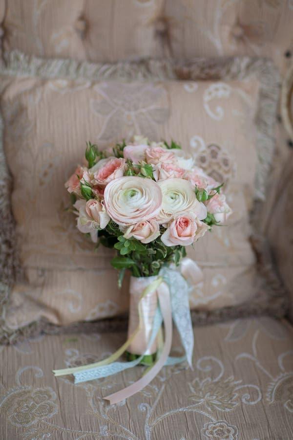 Elegant wedding flower bridal bouqet on texture sofa royalty free stock photo