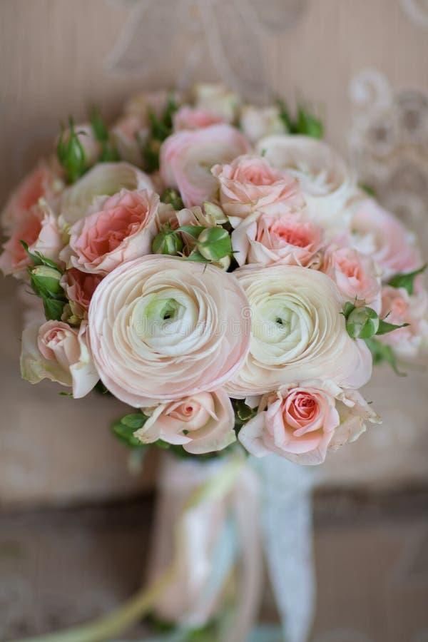 Elegant wedding flower bridal bouqet on texture sofa royalty free stock photos