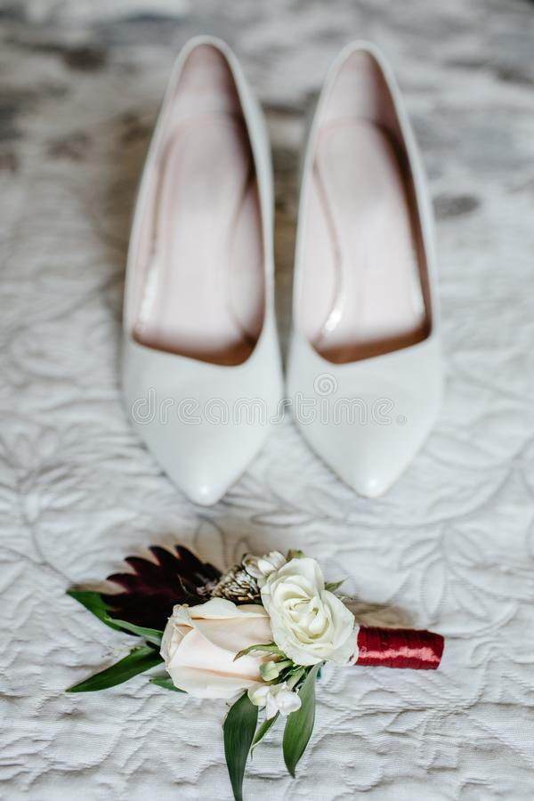 Elegant wedding shoes. Near other bride`s accessories on wedding day royalty free stock photos