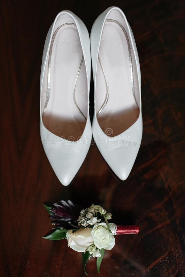 Elegant wedding shoes. Near other bride`s accessories on wedding day stock photos