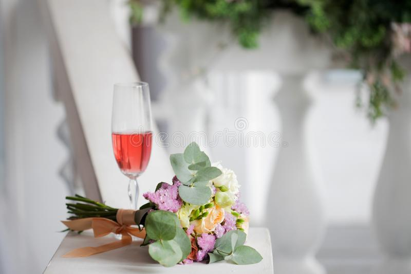 Elegant wedding still life. Bride`s bouquet of fresh flowers royalty free stock photos