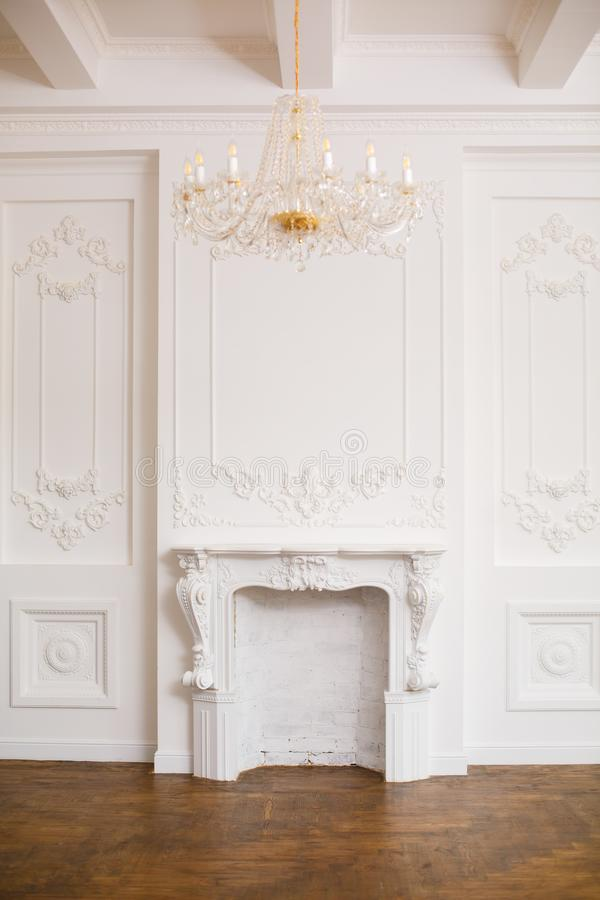Elegant white fireplace in beautiful white room. royalty free stock photos