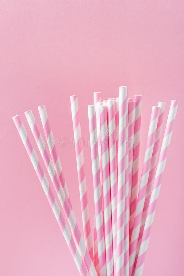 Elegant White Paper Drinking Straws with Pink Stripes Pattern Ornament on Fuchsia Background. Birthday Party Fun Kids Holiday royalty free stock images