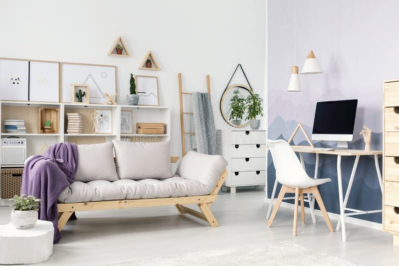 Elegant room with beige sofa stock photography