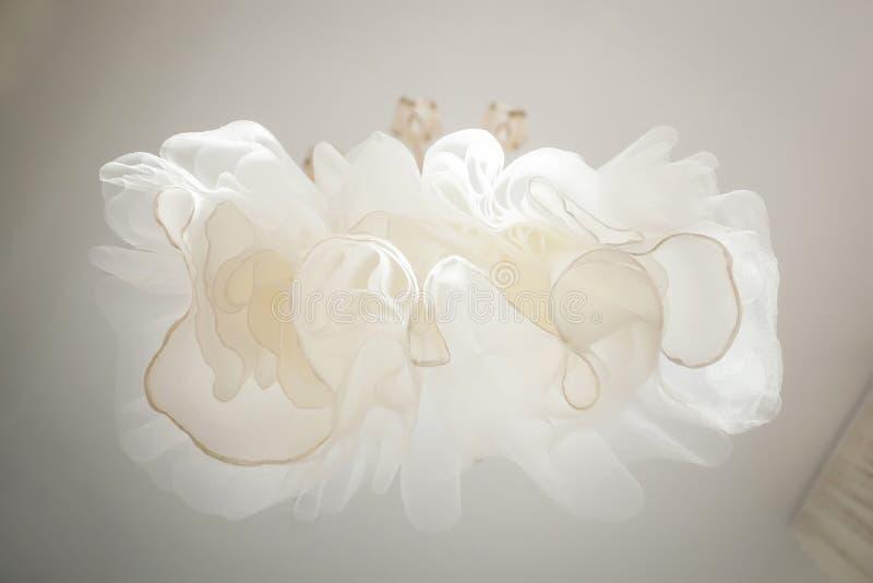 Elegant white wedding dress on a hanger.  stock photos