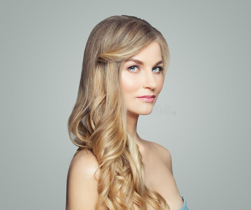 Elegant woman with blonde hair and clear skin stock photography