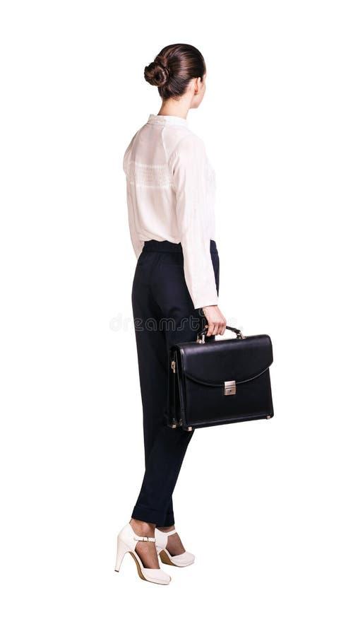 Elegant woman in business suit walking away. royalty free stock photos