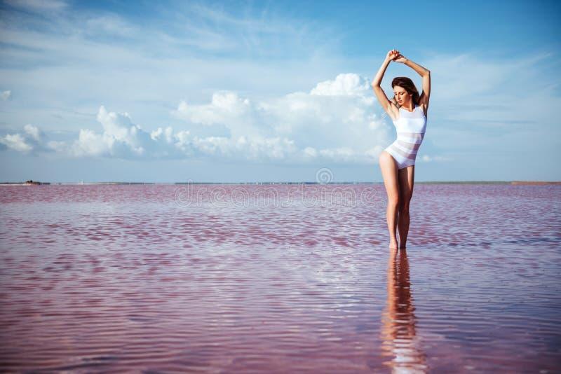 Elegant woman dancing on water. stock photos