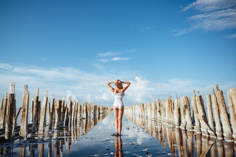 Elegant woman dancing on water. stock images