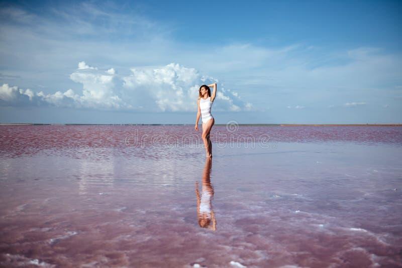 Elegant woman dancing on water. stock image