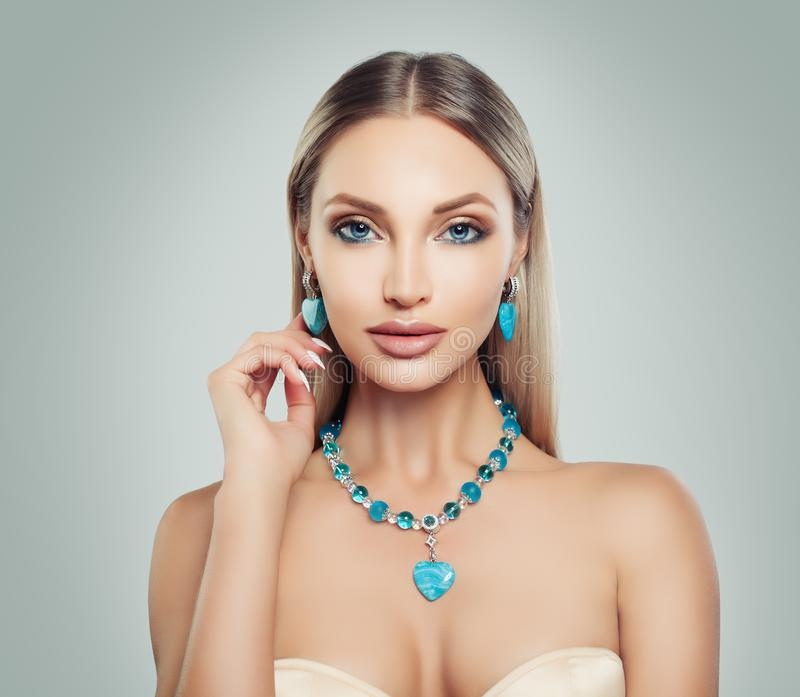 Elegant Woman Fashion Model with Makeup and Jewelry. royalty free stock photos