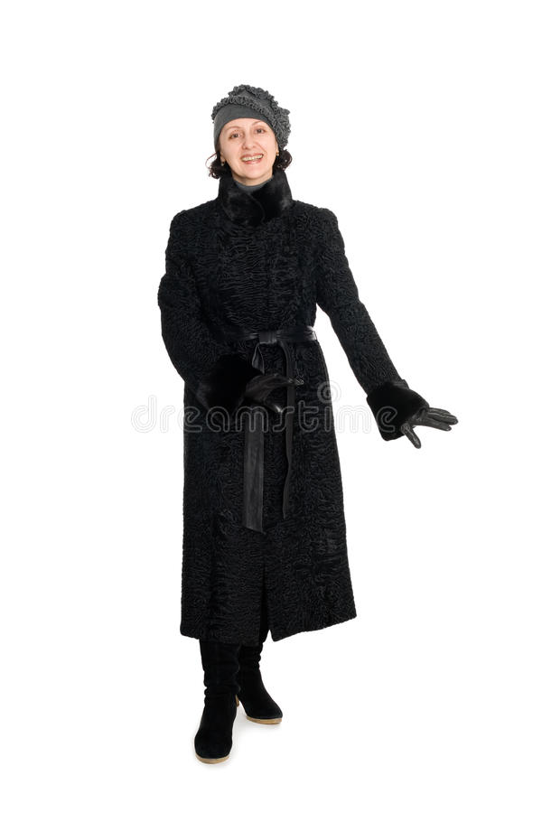 Elegant woman in a fur coat from broadtail royalty free stock photography