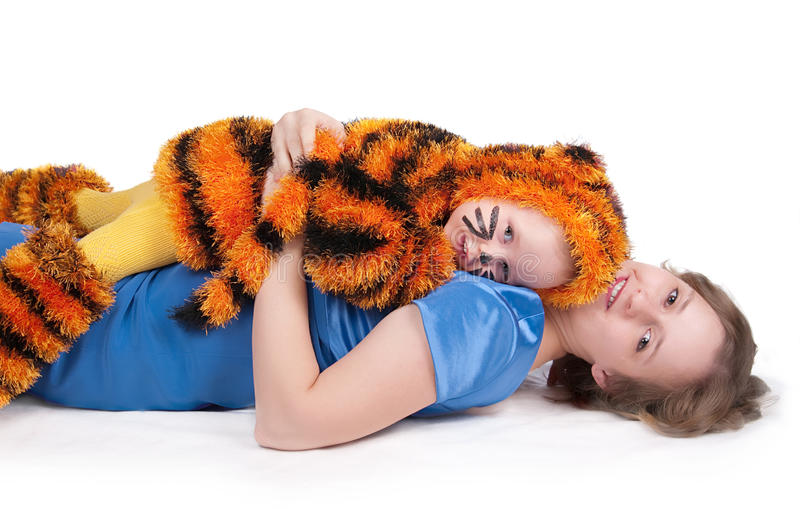 Download Elegant Woman And The Girl In A Suit Of A Tiger Stock Photos - Image: 11676113