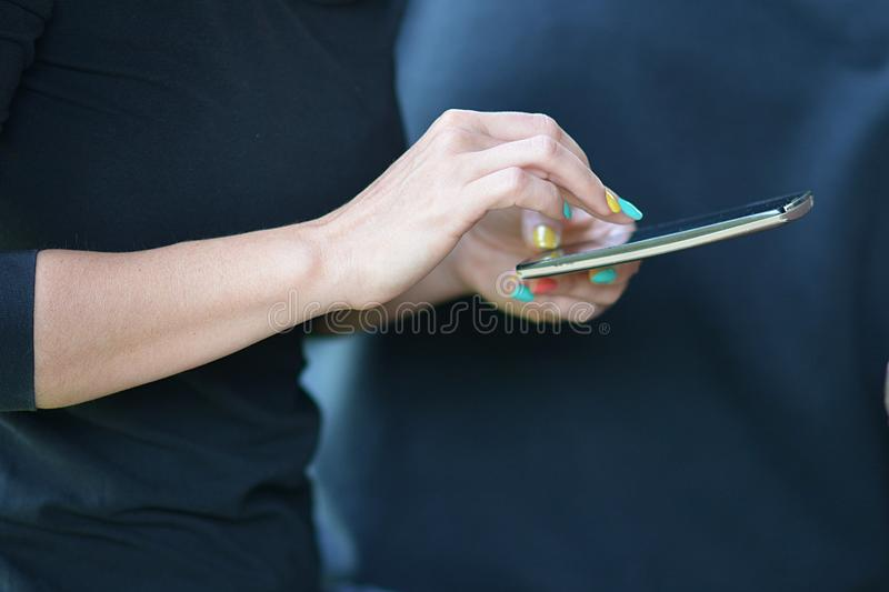 Elegant woman hands holding a smart phone. And background royalty free stock photos