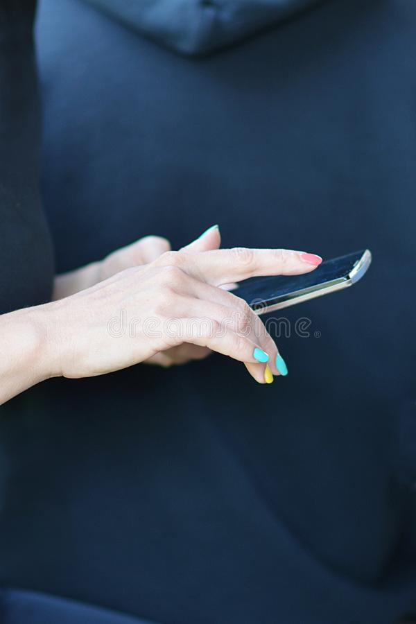 Elegant woman hands holding a smart phone. And background stock photos